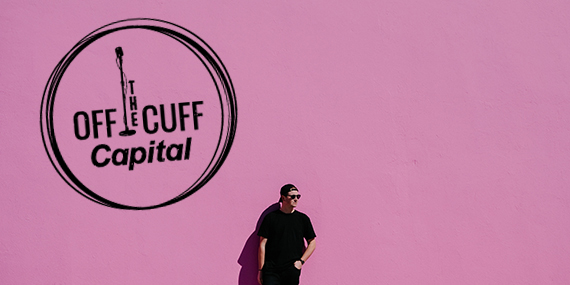 Man in front of pink wall with off the cuff logo