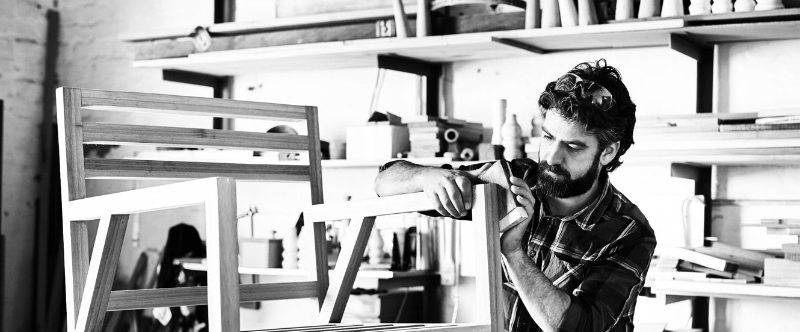 A man working in his wood shop.