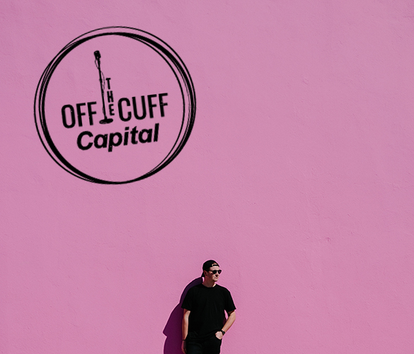 man standing in front of a pink wall