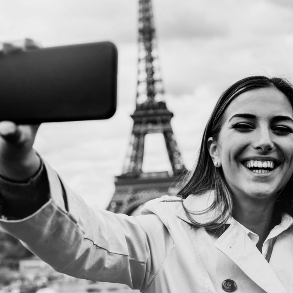 Woman taking selfie in Paris