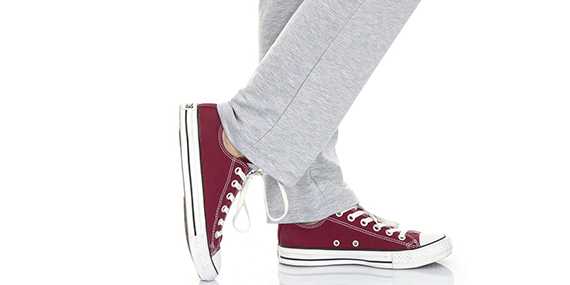 Girl wearing sweatpants with red Converse
